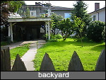 fenced backyard, carport and sundeck